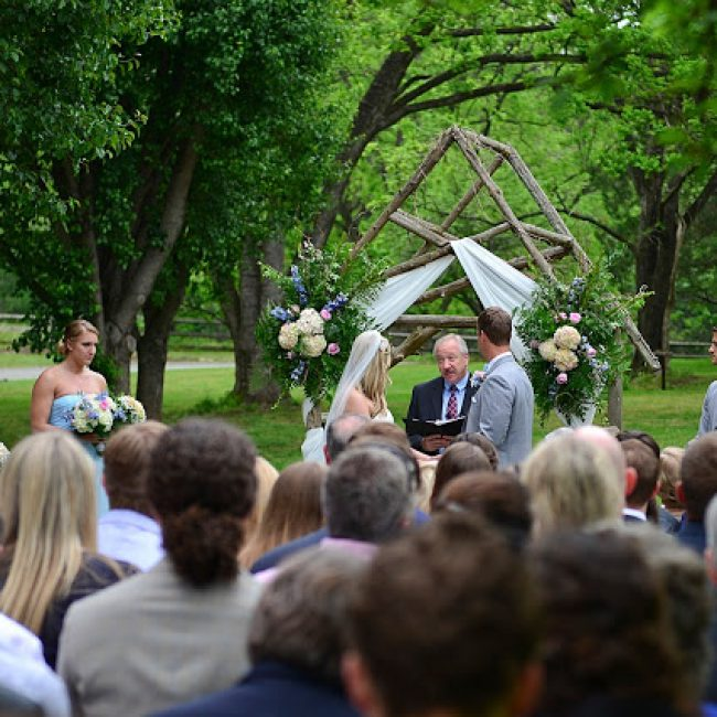 wedding ceremony in apple orchard featuring couple at the altar