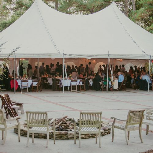 Wedding tent and court with guests having dinner